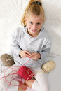 Little child learns to knit.