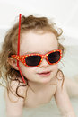 Little child plaing in the bath playing with sunglasses Royalty Free Stock Photography