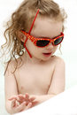 Little child plaing in the bath toddler playing with sunglasses Stock Photo