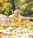 Little child playing autumn leaves gold Royalty Free Stock Photo