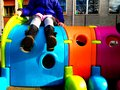 stock image of  Little child playing otudoor in a playground with a colourful toy, fun and play concept