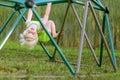 Little Child Playing at PLayground Climbing on Monkey Bars Royalty Free Stock Photo