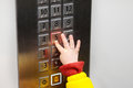 Little child pressing button in elevator Royalty Free Stock Photo
