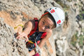 Little Child in protective Helmet climbing Rock Royalty Free Stock Photo