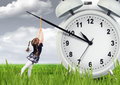 Little child pulling hand clock, time stop concept Royalty Free Stock Photo