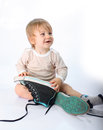 Little child sitting with shoes Stock Images