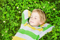 Little child sleeping outdoors on grass Royalty Free Stock Images