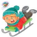 Little child slides on a sled