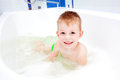 Little child smiling in bath happy childhood the Royalty Free Stock Images