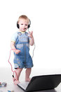 Little child speaking on a headset Royalty Free Stock Photos