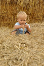 Little child in straw Royalty Free Stock Images