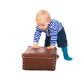 Little child with a suitcase isolated the beautiful on white background Royalty Free Stock Images