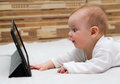 Little child touching his tablet computer Royalty Free Stock Photography