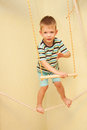 Little child walking on a tightrope in the sports complex balance training Royalty Free Stock Images