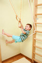 Little child walking on tightrope in the sports complex a balance training Stock Image