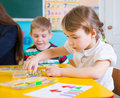Little children at applique lesson cute having kindergarten Royalty Free Stock Photography