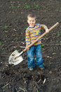 Little children with big shovel Royalty Free Stock Photo