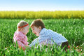 Little children boy and girl play on green grass Royalty Free Stock Photo