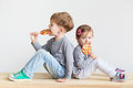 Little children eating lollipops Royalty Free Stock Photo