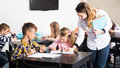 Little children with teacher in classroom Royalty Free Stock Photo