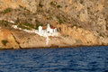 Little church on a rocky coast near nafplio greece Stock Image