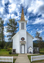 Little church very small white with a white picket fence out front Royalty Free Stock Image
