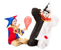 Little clown girl scaring pierrot making balloon explode Royalty Free Stock Photos