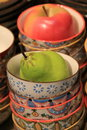 Little colorful bowls with decorative fruit on table Royalty Free Stock Photo