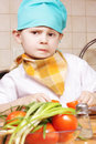 Little cook in perplexity Royalty Free Stock Photo