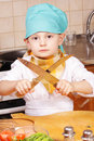 Little cook sharpening knives Stock Photo