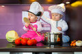 Little cook twins. Royalty Free Stock Photo