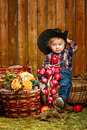 Little cowboy on a farm in a hat and jeans after harvest Royalty Free Stock Photos