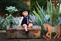 Little cowboy in the garden Royalty Free Stock Photo