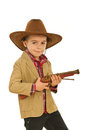Little cowboy holding weapon toy Royalty Free Stock Images