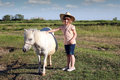 Little cowboy and pony horse child Royalty Free Stock Image