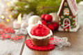Little cupcake with santa hat a made of frosting Royalty Free Stock Photo