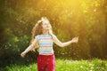 Little curly girl enjoy flying dandelion in sunset light. Instagram filter. Healthcare, breathing, medical, allergy, happy Royalty Free Stock Photo