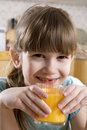 Little cute adorable  girl  drink orange juice Stock Image