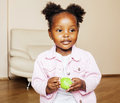 Little cute african american girl playing with animal toys at ho Royalty Free Stock Photo