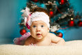 Little cute baby with christmas tree this image has attached release Stock Photography
