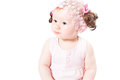 Little cute baby-girl with blue eyes  in pink dress isolated on white background Royalty Free Stock Photo