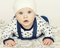 Little cute baby toddler on carpet isolated close up smiling ado