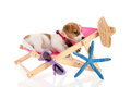 Little cute beach puppy resting chair Stock Photo