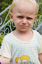 Little cute blond angry boy outdoor Stock Images