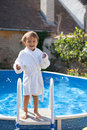 Little cute boy in a big swimming pool Royalty Free Stock Photo