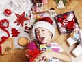 Little cute boy with Christmas gifts at home. close up emotional happy smiling in mess with toys, lifestyle holiday real Royalty Free Stock Photo