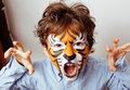 Little cute boy with faceart on birthday party Royalty Free Stock Photo