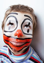 Little cute boy with facepaint like clown pantomimic expressions close up Stock Photography