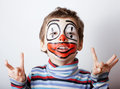 Little cute boy with facepaint like clown pantomimic expressions close up Royalty Free Stock Photos