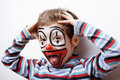 Little cute boy with facepaint like clown pantomimic expressions close up Royalty Free Stock Image